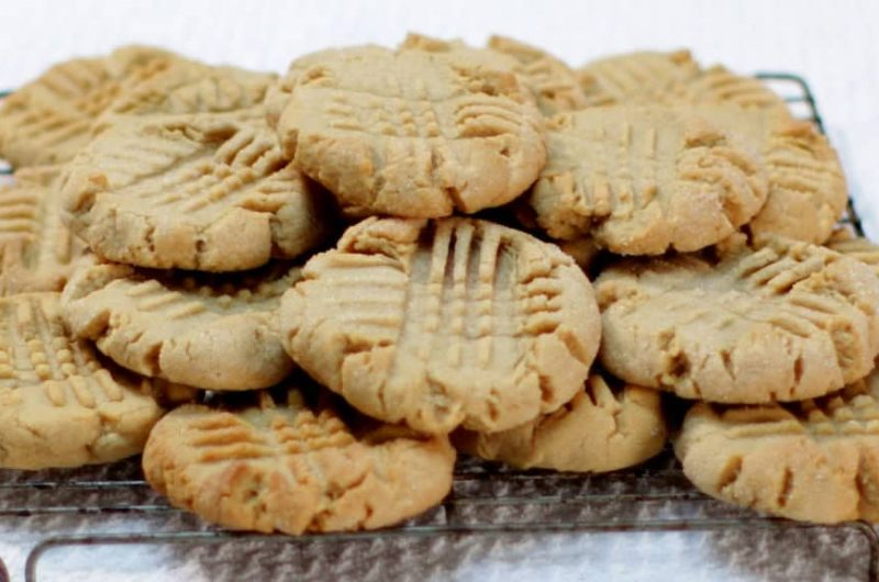 batch of peanut butter cookies sitting on wire rack
