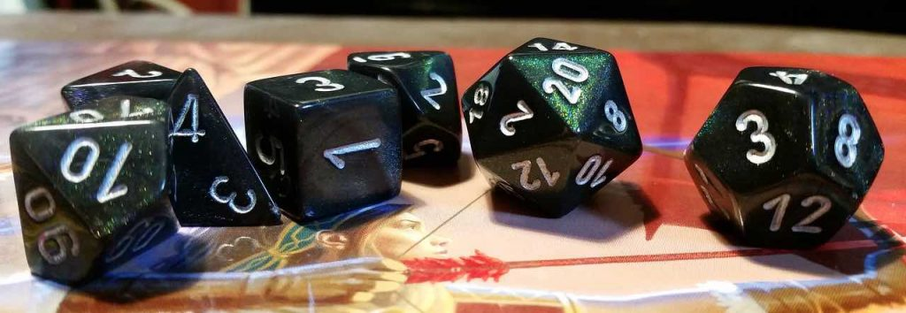 Set of green dice used to play dungeons and dragons.