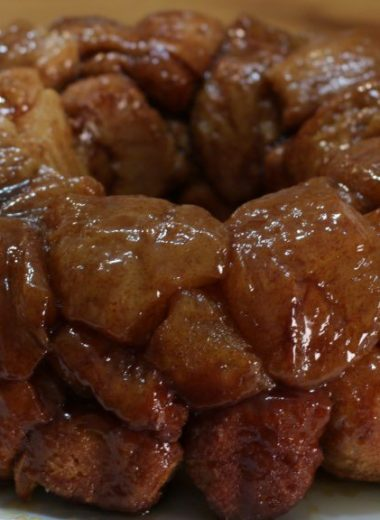 easy monkey bread nestled on a white plate on a wooden table