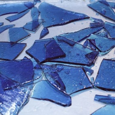 blue edible sugar glass on silver sheet pan