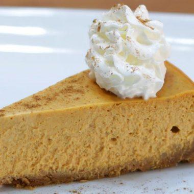 easy pumpkin cheesecake slice of cheesecake sitting on a white plate