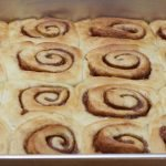 no knead cinnamon rolls recipe in a large baking pan