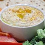 White plate of hummus and veggies