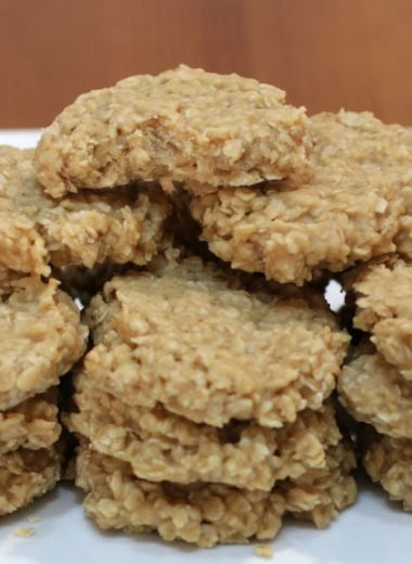 No-bake peanut butter cookies stacked on a plate