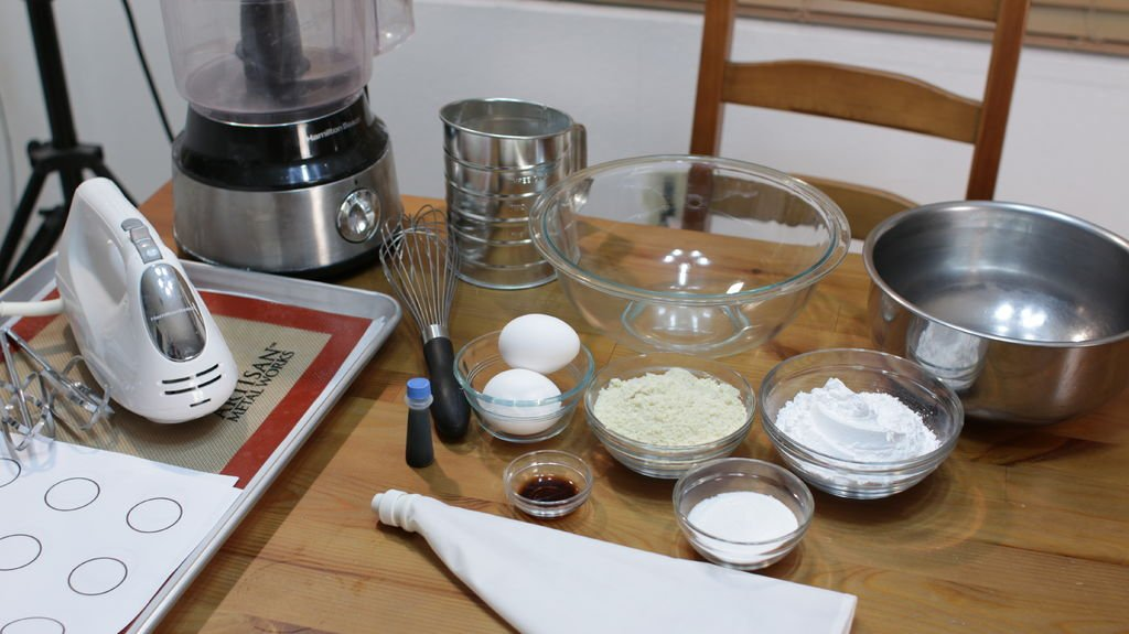 Ingredients in glass bowls for making classic French Macarons