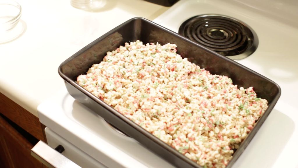 Rice Krispies treats in a 13x9 pan on a stovetop