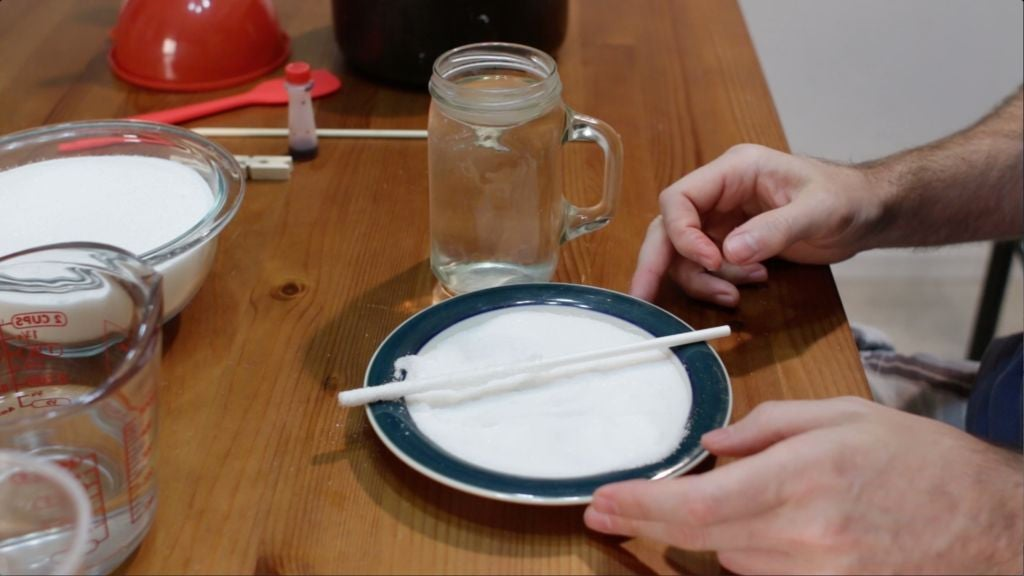 white stick covered in sugar on a plate