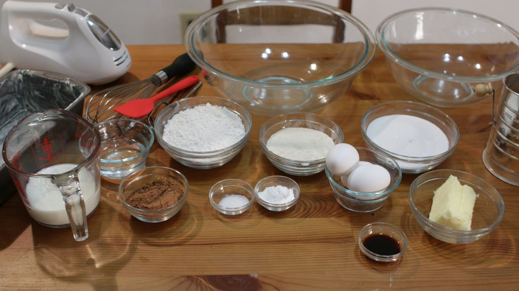 marble cake ingredients on a wooden table in glass bowls.