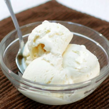 3 ingredient homemade vanilla ice cream in a bowl on a brown towel