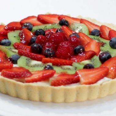 Fruit tart on a white cake pedestal