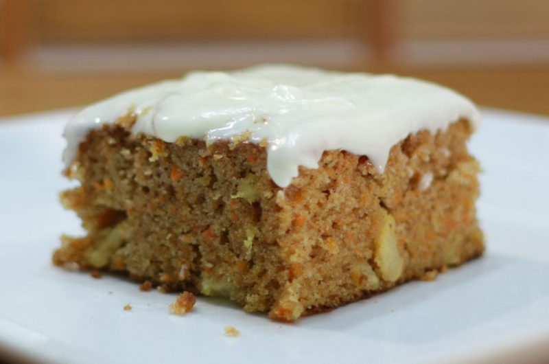 Moist carrot cake on a white plate on a table