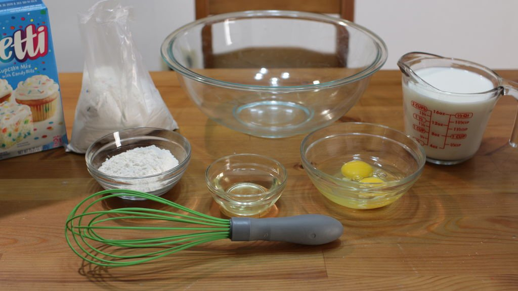 Tools and ingredients for making funfetti cake mix pancakes.