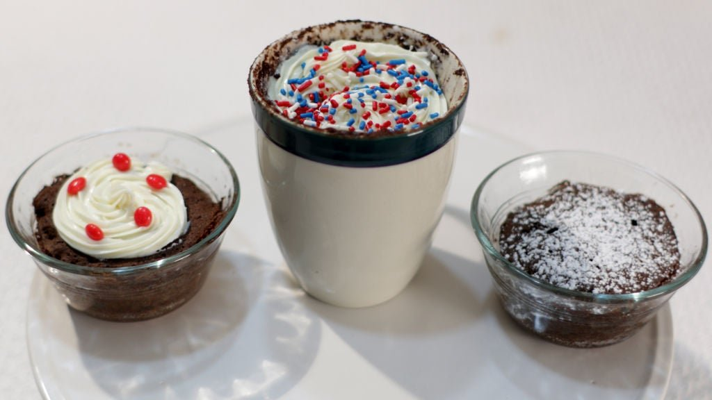 mug and bowl cakes on a table white table.