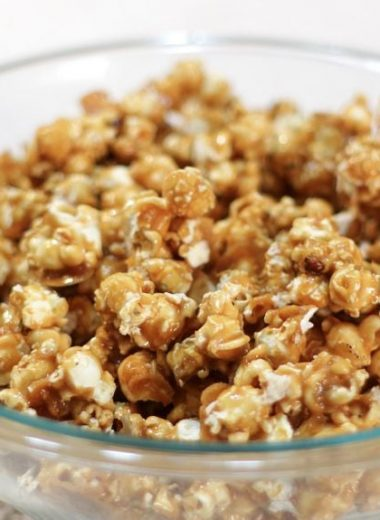 caramel popcorn in a large glass bowl