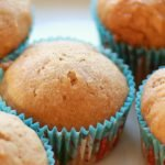 freshly baked applesauce muffins on a white plate