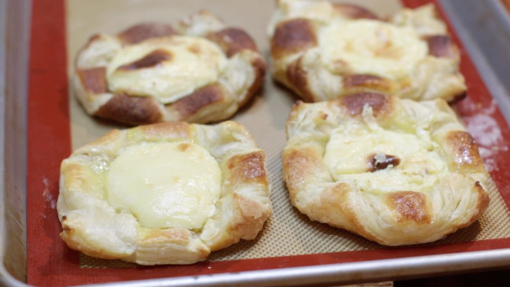 Freshly baked easy to make cheese danish on a sheet pan.