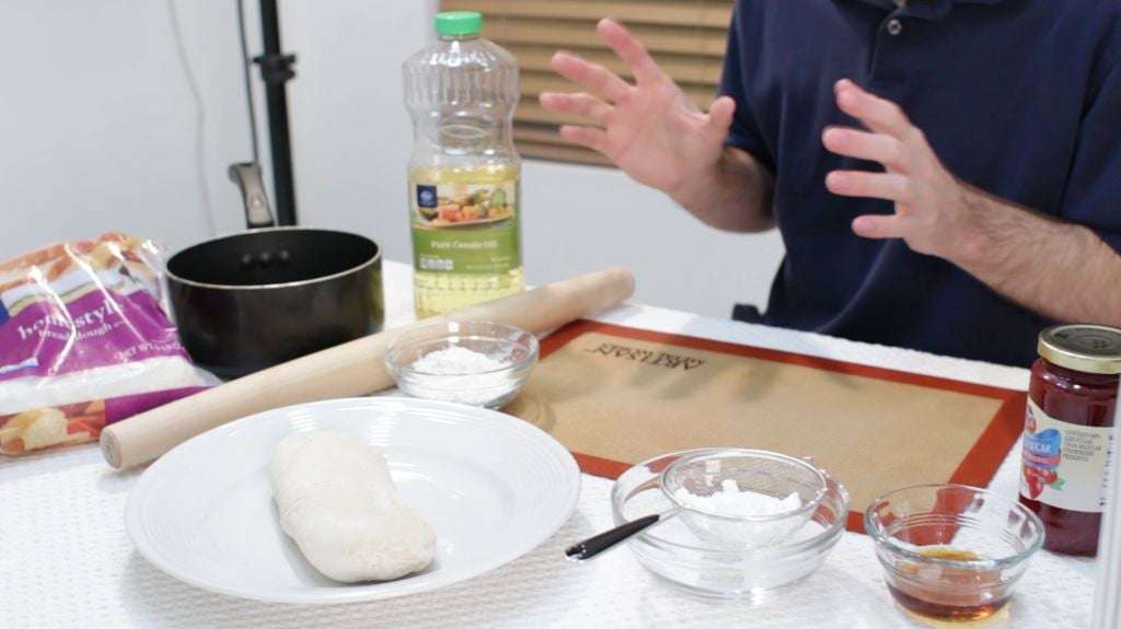 Fry bread ingredients on the table frozen bread, honey, jam, powdered sugar.