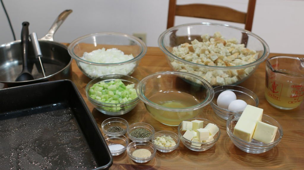 Stuffing ingredients in bowls on a wooden table.