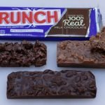 Homemade copycat Nestle crunch bars on a white cutting board.