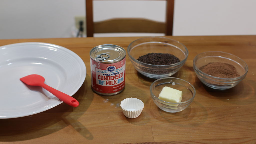 Brigadeiro ingredients in bowls on a wooden table