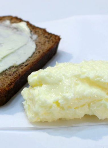 Easy homemade butter on a plate with slice of banana bread