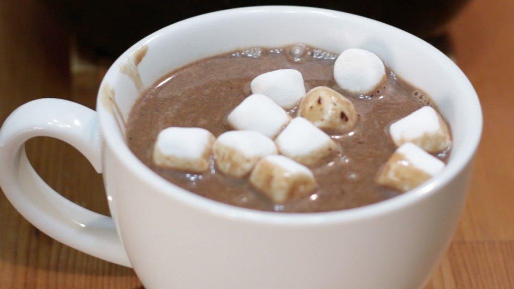 White mug full of homemade hot chocolate and marshmallows