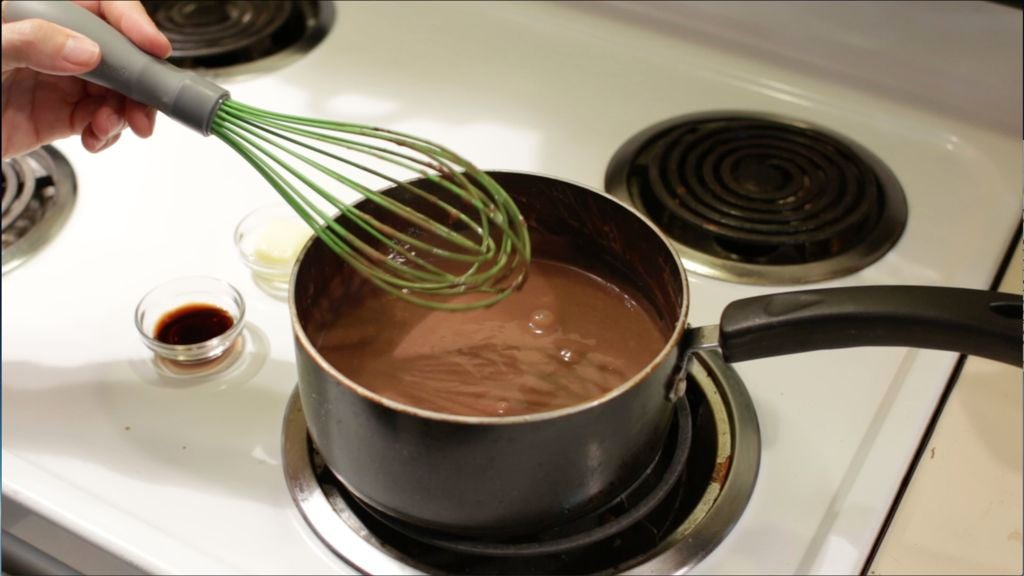 Medium pot with fudge pops liquid in it on a stovetop