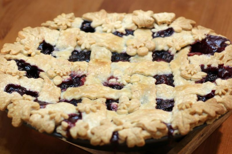 Triple berry pie on a wooden table