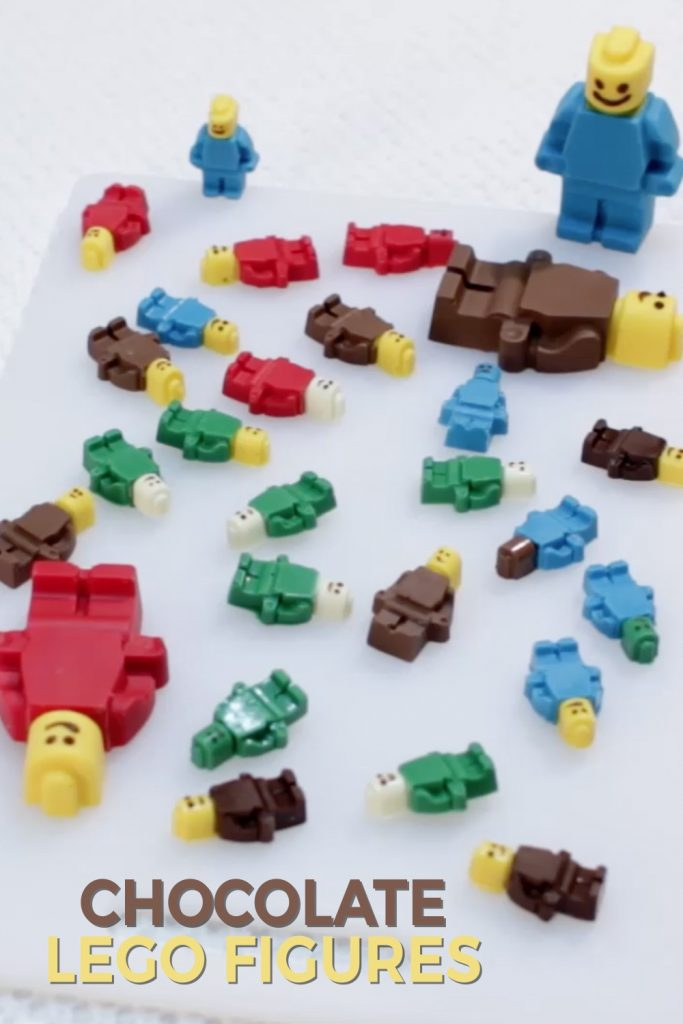 Several chocolate lego figures on a table.