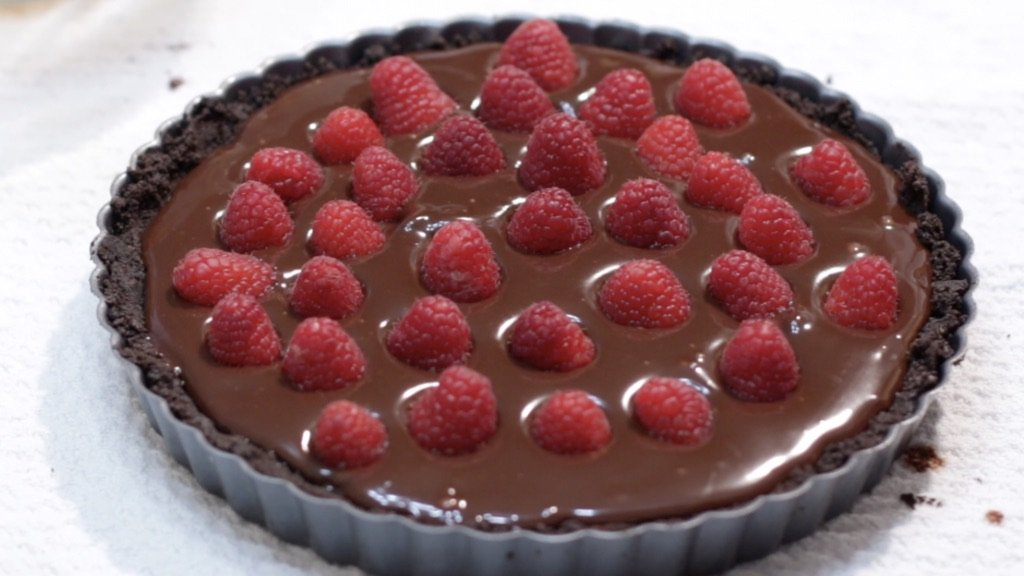 Chocolate raspberry tart ready to go in the fridge.