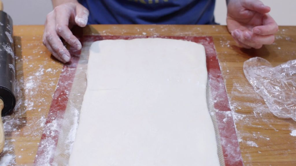 Rolled out homemade puff pastry dough.