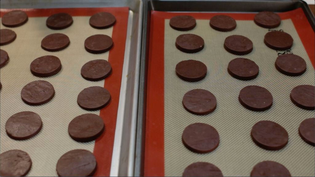 Several thin mint cookies on two sheet pans.
