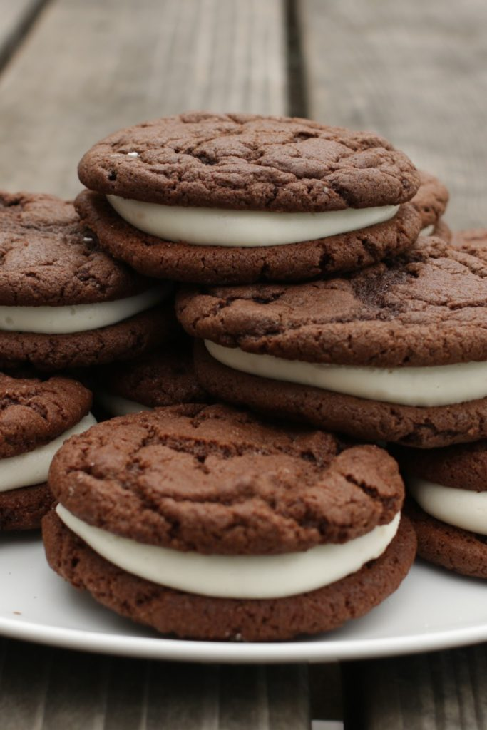 Whoopie pies on a plate on a picnic table