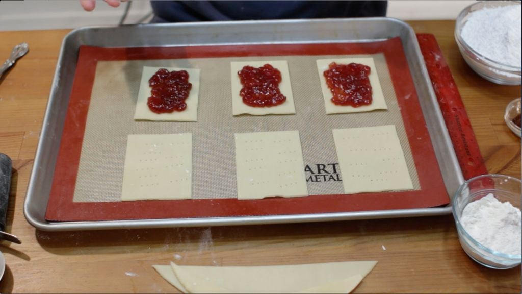 Strawberry preserves added to the middle of sheets of homemade pop tarts