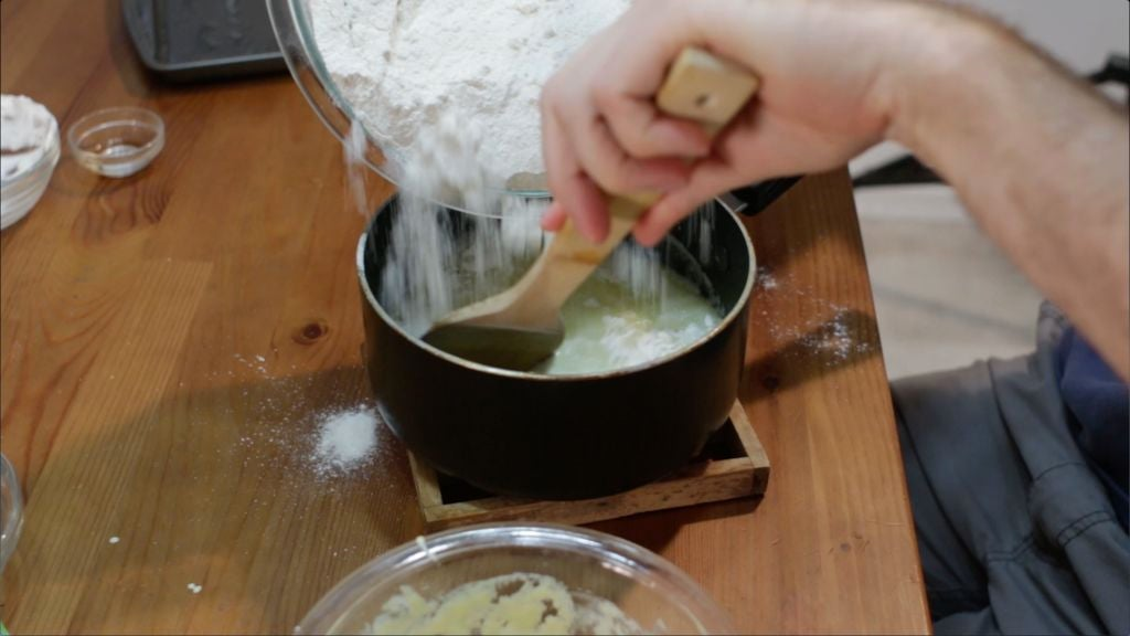 Combining the flour mixture with the butter and water mixture
