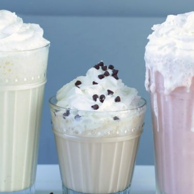 Three homemade milkshakes on a plate.