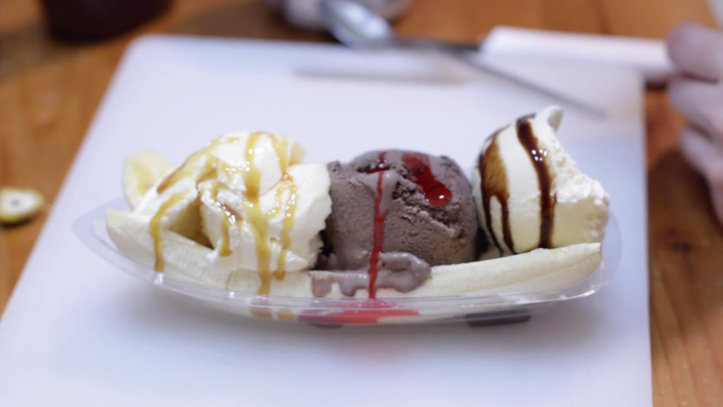 Scoops of ice cream on top of banana split