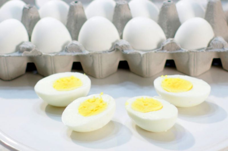 perfect hard boiled eggs on a white plate