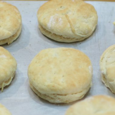 several homemade biscuits on a metal sheet pan