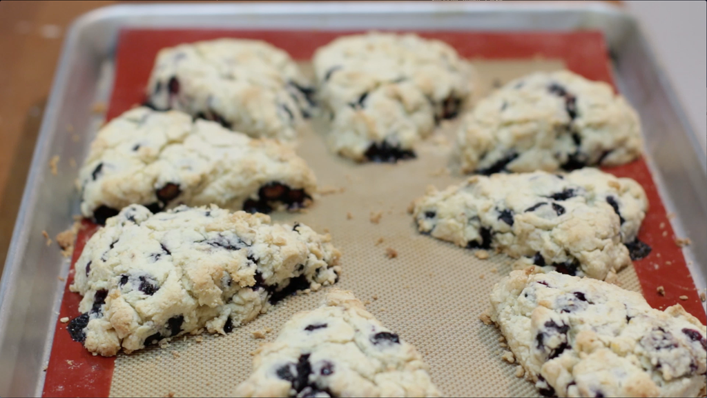 Sheet pan full of homemade baked blueberry scones.