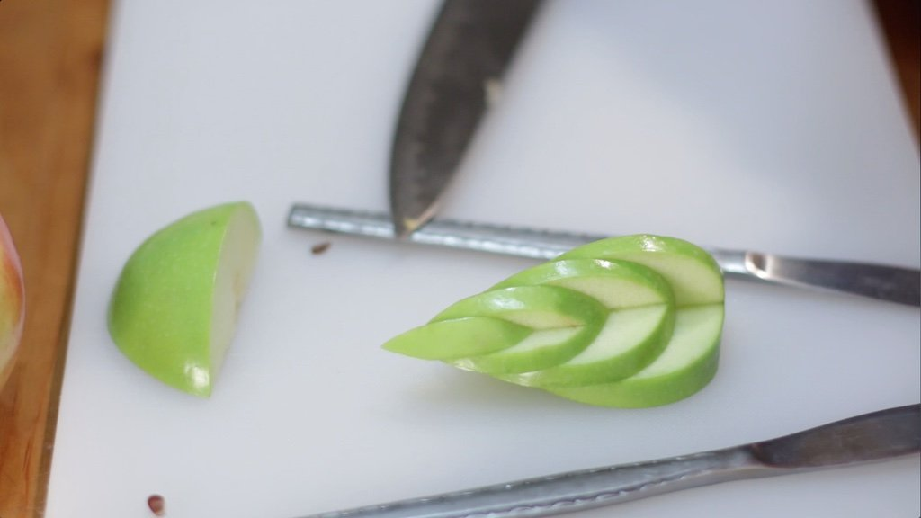 Apple swan wing assembled with 4 apple wedge slices.