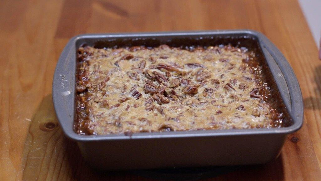 Pan of freshly baked pecan pie brownies.