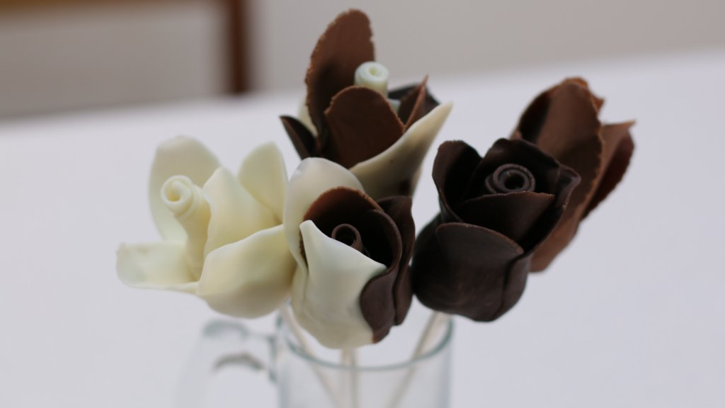 White and brown modeling chocolate roses.