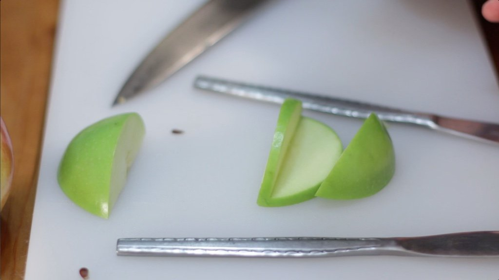 Medium apple wedge cut from a larger apple wedge.