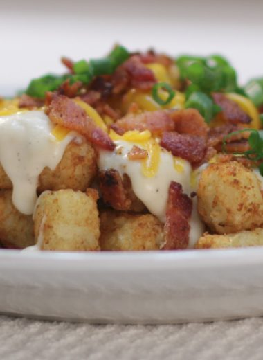 White plate with a mound of totchos on it.