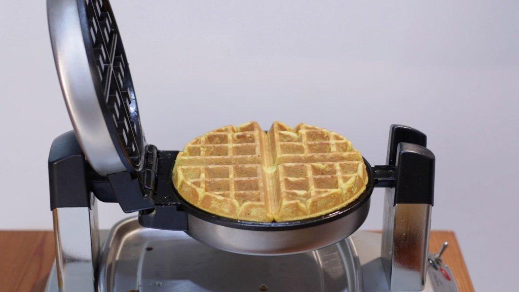 Freshly cooked pumpkin waffle on the waffle iron.