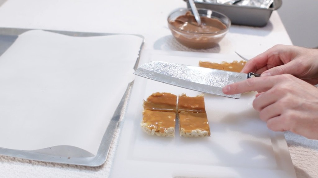 Snickers crisper candy bar cut into squares before dipped in chocolate.
