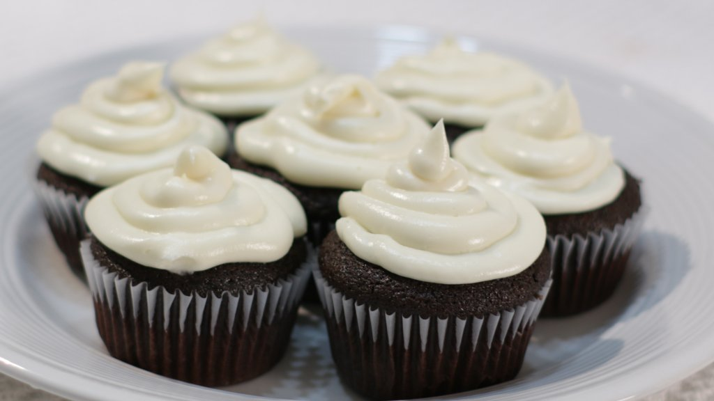 Plate with 7 frosted easy chocolate cupcakes.