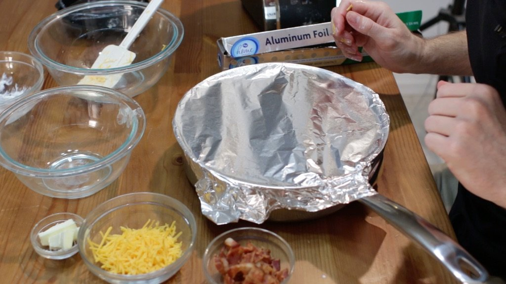 Pot of homemade mac and cheese covered with foil