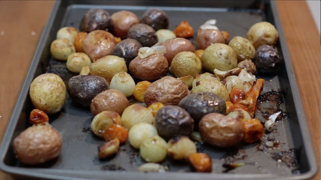 Roasted baby potatoes on a sheet pan.